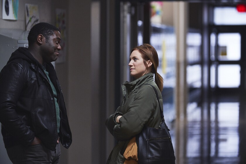 Sam Richardson and Brittany Snow in the movie 'Hooking Up'