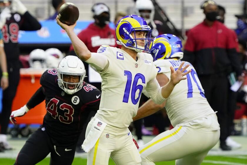 Rams quarterback Jared Goff throws as Arizona Cardinals outside linebacker Haason Reddick pursues.