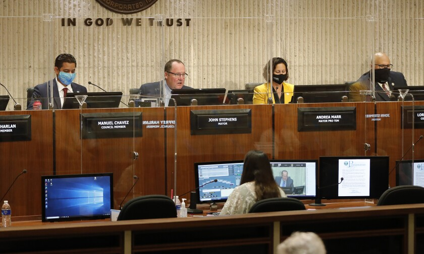 Mayor John Stephens begins the Costa Mesa City Council proceedings during a return to in-person meetings Tuesday.