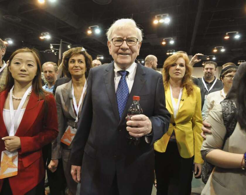 Warren Buffett, touring the exhibit floor at a 2012 Omaha shareholders meeting, makes the case for expanding economic opportunities for women.