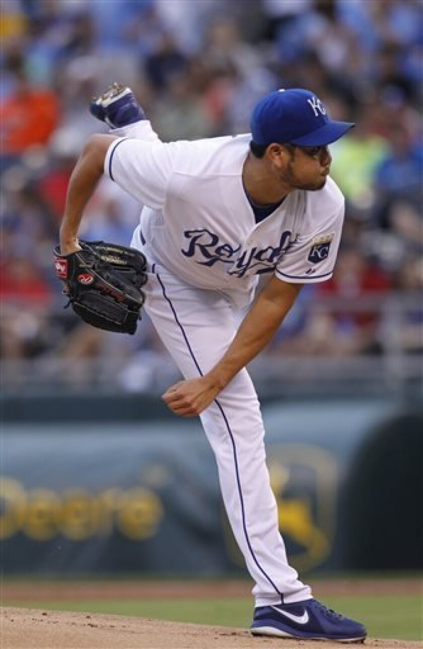 Kansas City Royals pitcher Bruce Chen throws in the first inning of a baseball game against the Kansas City Royals at Kauffman Stadium in Kansas City, Mo., Thursday, Aug. 8, 2013. (AP Photo/Colin E. Braley)