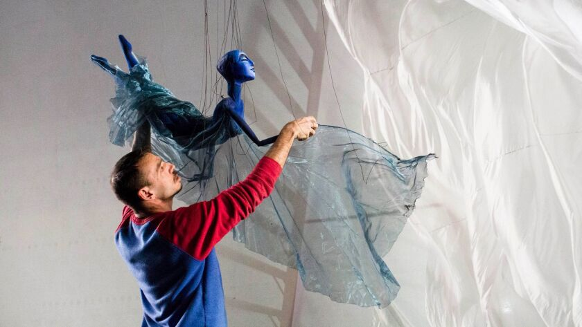 CHAPEL HLL, NC - MAR 12: Basil Twist directs his cast of puppeteers through a rehearsal on the stage