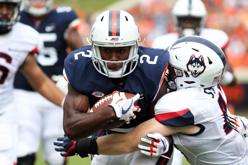 Virginia's Joe Reed carries the ball against Connecticut in September 2017.