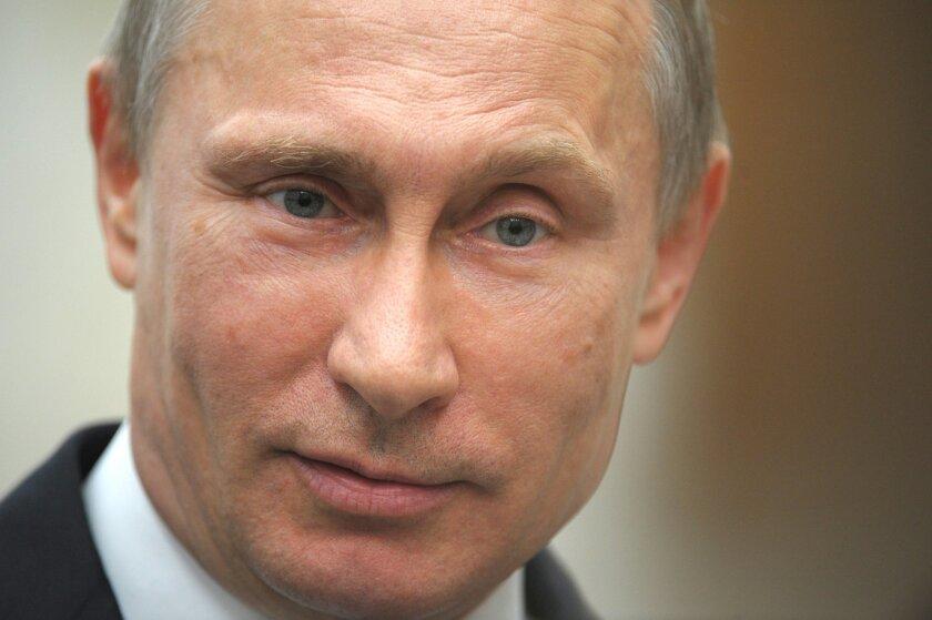 In this Tuesday, April 29, 2014 photo, Russian President Vladimir Putin speaks to press after a meeting of the Eurasian Economic Council in Minsk, Belarus. (AP Photo/RIA-Novosti, Alexei Druzhinin, Presidential Press Service)