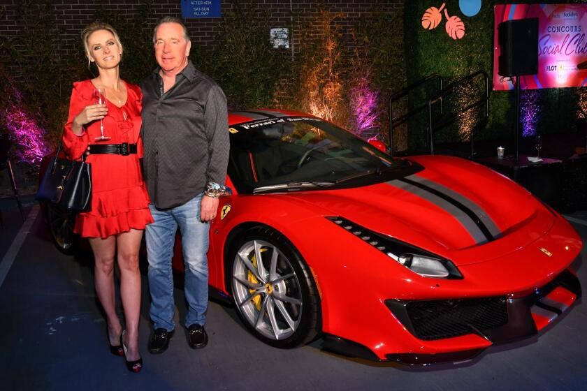 Michael Fenison and friend, with a Ferrari