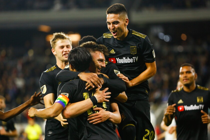 LOS ANGELES, CALIF. - MAY 24: Los Angeles FC defender Tristan Blackmon (27) and teammates celebrate Blackmon's goal against the Montreal Impact during a Major League Soccer game between the Montreal Impact and the Los Angeles FC at Banc of California Stadium on Friday, May 24, 2019 in Los Angeles, Calif. (Kent Nishimura / Los Angeles Times)
