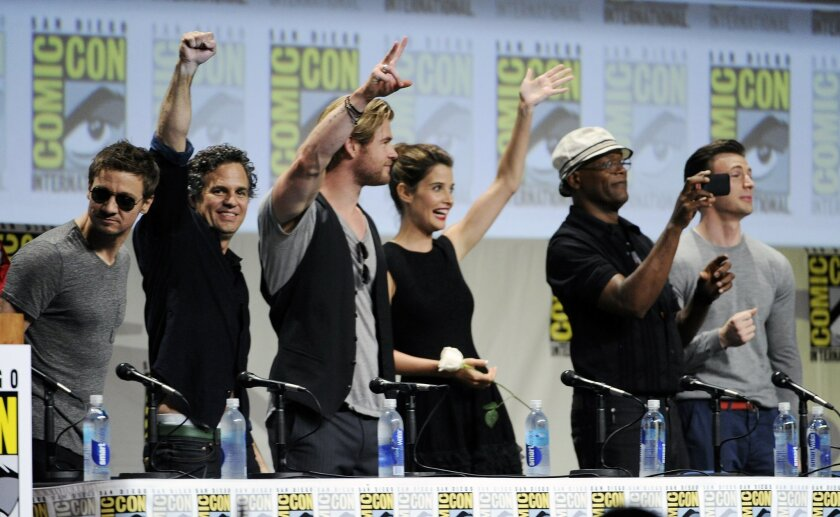 Actors Jeremy Renner, from left, Mark Ruffalo, Chris Hemsworth, Cobie Smulders, Samuel L. Jackson and Chris Evans stand during the Marvel panel at Comic-Con International on Saturday, July 26, 2014, in San Diego. (Photo by Chris Pizzello/Invision/AP)