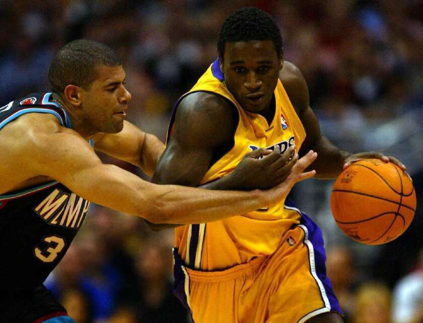 Kareem Rush, right, playing for the Lakers in 2004, fights off Shane Battier.