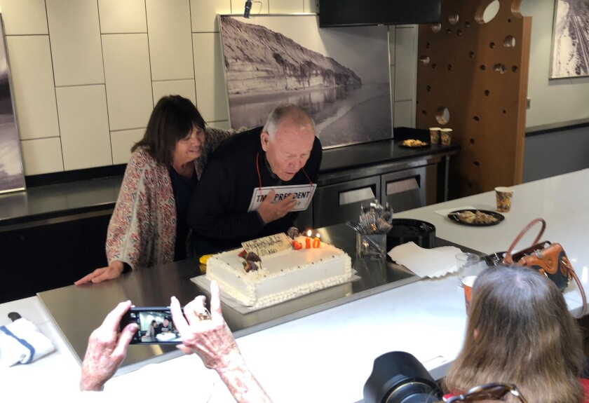 Skip Stratton, with his wife Tracey, blew out the candles at his 80th birthday party.