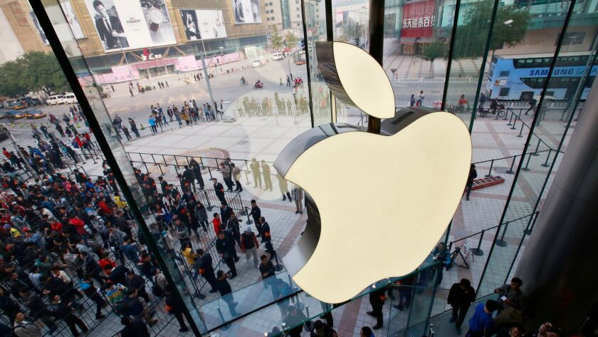 Fans line up outside the new Apple Store in the Wangfujing shopping district in Beijing in 2012.