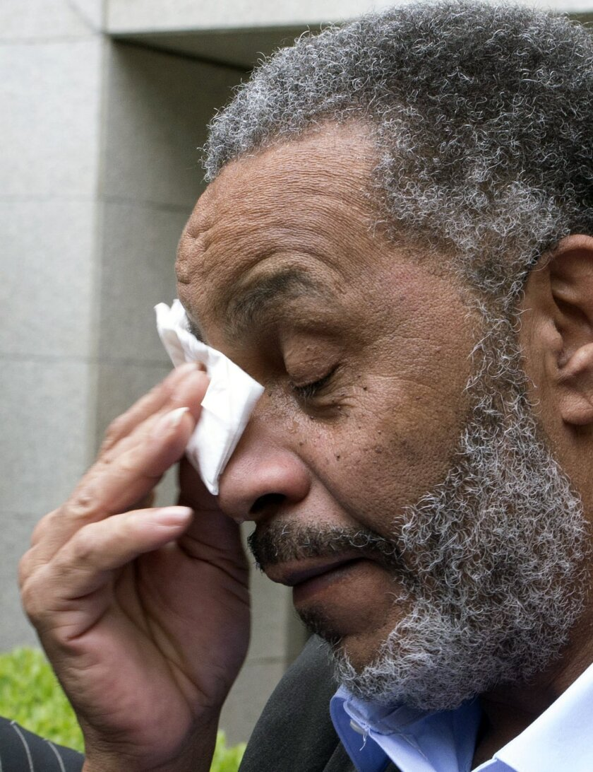 Anthony Ray Hinton wipes away tears after greeting friends and relatives upon leaving the Jefferson County jail, Friday, April 3, 2015, in Birmingham, Ala. Hinton spent nearly 30 years on Alabama's death row, and was set free Friday after prosecutors told a judge they won't re-try him for the 1985