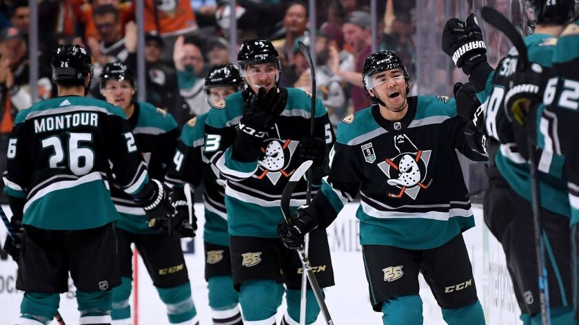 Kiefer Sherwood of the Ducks, second from right, celebrates his goal against the Buffalo Sabres.