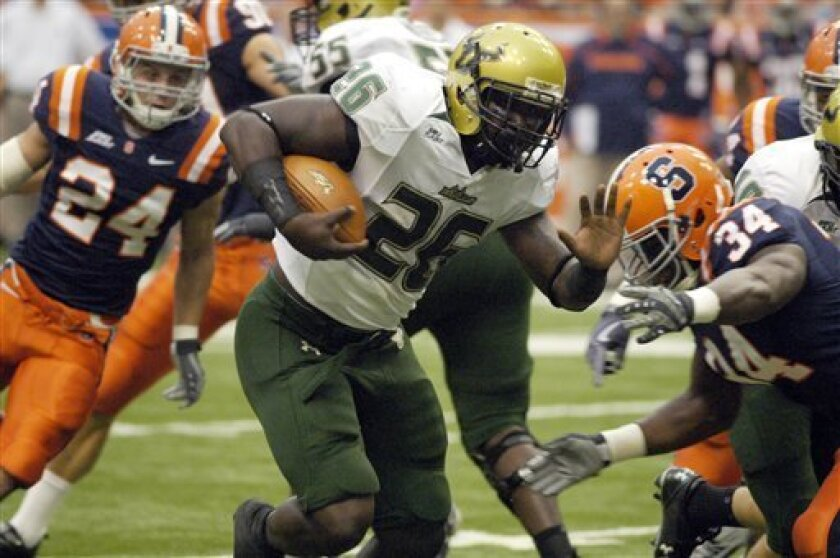 South Florida running back Mike Ford runs for a touchdown against Syracuse during the first quarter in an NCAA college football game in Syracuse, N.Y., Saturday, Oct. 3, 2009. (AP Photo/Kevin Rivoli)