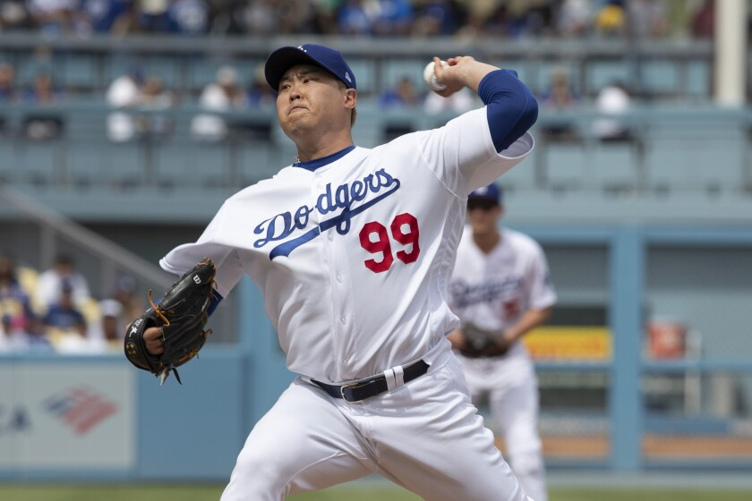 Los Angeles Dodgers starting pitcher Hyun—Jin Ryu throws to Colorado Rockies' Trevor Story during the first inning of a baseball game in Los Angeles, Sunday, Sept. 22, 2019. (AP Photo/Sam Gangwer )