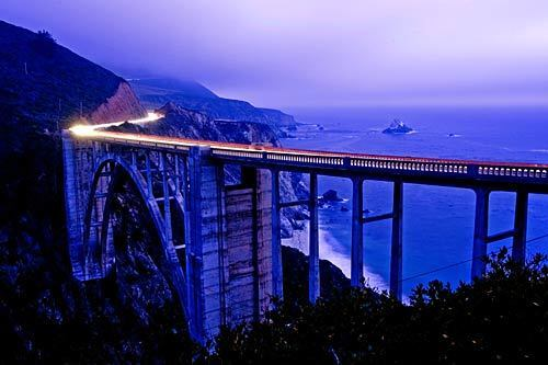 A time-exposure photo shows traffic on Pacific Coast Highway going over the historic Bixby Bridge in Big Sur.