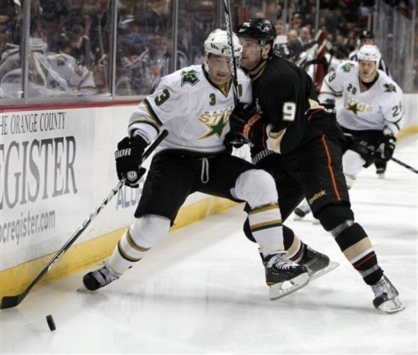 Anaheim Ducks' Bobby Ryan collides with Dallas Stars' Stephane Robidas during the first period of an NHL hockey game in Anaheim Calif., on Sunday, April 3, 2011. (AP Photo/Christine Cotter)
