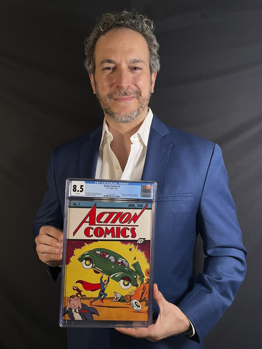 This photo provided by Metropolis Collectibles on Tuesday, April 6, 2021, shows Vincent Zurzolo, co-owner of ComicConnect, holding Action Comics first edition 1938 comic book marking Superman's first appearance, which has sold for an historic, record-breaking $3,250,000. (Courtesy of Metropolis Collectibles via AP)