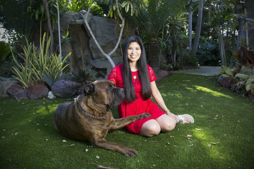 A pre-haircut  Lori M. Walton with the family dog. Cortez, in the backyard of the Waltons' home in Marston Hills.