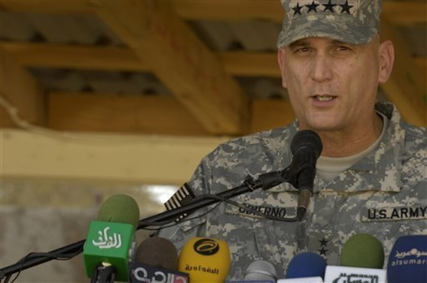 In this image provided by the Department of Defense Multi-National Force-Iraq commander, Gen. Raymond T. Odierno, U.S. Army, address a news conferance at Camp Echo, Iraq, in this Oct. 4, 2008 photo. Odierno told reporters Saturday Dec. 13, 2008 that thousands of U.S. troops will remain in Iraqi cities at local security stations after the summer deadline to have combat troops out of the urban areas. They would serve as training and mentoring teams, and thus would not be included in the mandate to pull combat troops from the cities. (AP Photo/Department of Defense - Airman 1st Class Matthew Plew, U.S. Air Force)