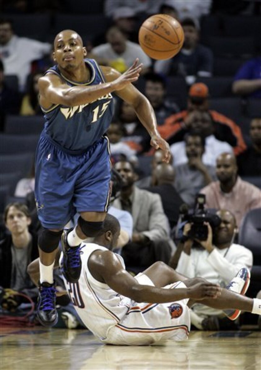 Washington Wizards guard Randy Foye pushes the ball up court after a turnover by Charlotte Bobcats guard Raymond Felton in the first half of an NBA basketball game Tuesday, Feb. 9, 2010 in Charlotte, N.C. (AP Photo/Nell Redmond)