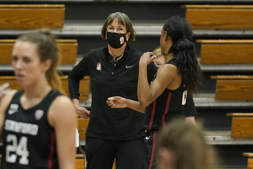 Stanford head coach Tara VanDerveer talks with Stanford guard Kiana Williams during a break in the action against Pacific in the first half of an NCAA college basketball game in Stockton, Calif., Tuesday, Dec. 15, 2020. With a win over Pacific, VanDerveer will become the winningest women's coach in history breaking Pat Summitt's record of 1,098. (AP Photo/Rich Pedroncelli)