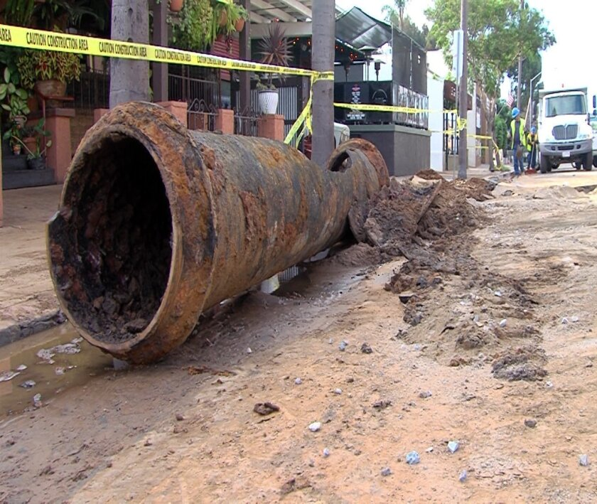 Two cast iron pipes burst Tuesday afternoon, causing flooding and closing roads in Hillcrest and North Park.