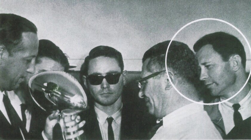 NFL Chairman Pete Rozelle, left,  awards the first Super Bowl trophy to Vince Lombardi, coach of the Green Bay Packers 50 years ago. The circled figure to Lombardi's right is Dion Rich, who sneaked into the photo op.