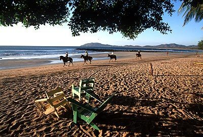 Renting horses for a ride on the beach at Tamarindo, on Costa Rica's northwest coast, is a popular excursion for visitors.