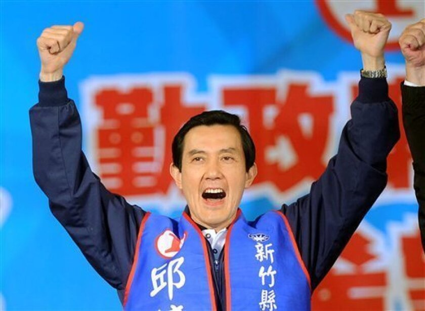 Nationalist Party Chairman and Taiwanse President Ma Ying-jeou cheers during a campaign rally, Friday, Dec. 4, in Hsinchu city, northern Taiwan. Taiwan's pro-independence opposition Democratic Progressive Party is hoping to claw its way back from the brink in Saturday's county and municipal poll, after suffering crushing defeats in last year's legislative and presidential elections. (AP Photo)