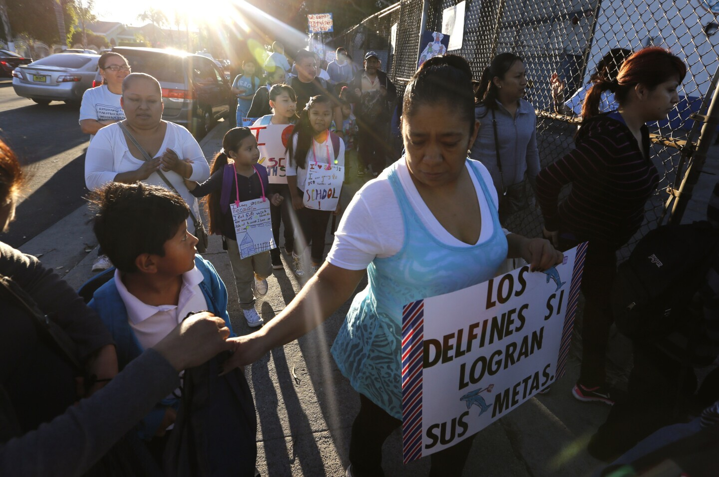 """Parents, teachers and students carry signs and banners during a """"walk-in"""" to show their loyalty to 20th Street Elementary School in Los Angeles on Wednesday. The rally was to show support for traditional public schools."""