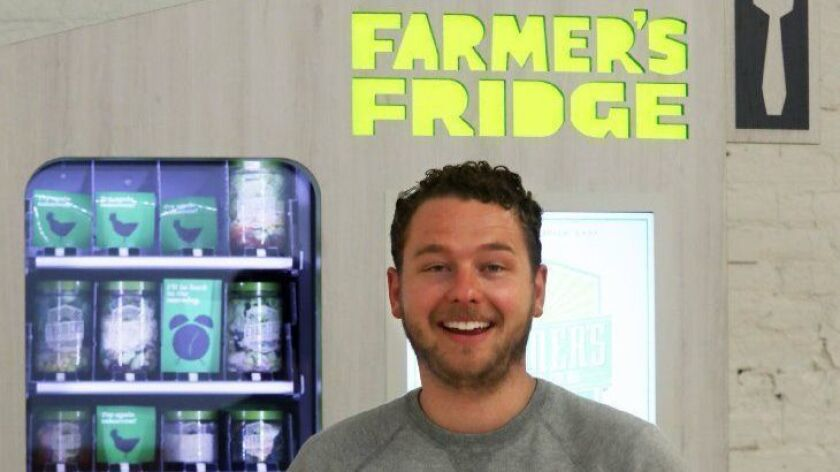 Luke Saunders, founder and CEO of Farmer's Fridge, stands with one of the company's vending machines on April 17, 2017. The company has closed a $30 million round of financing and plans to double its operations.