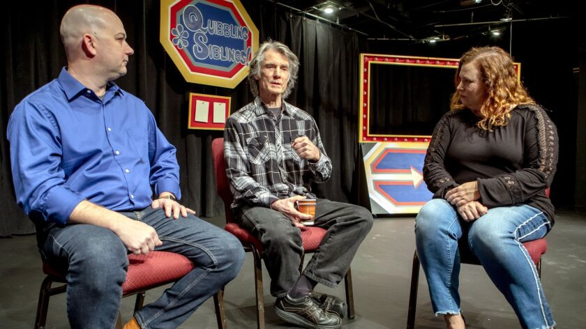"""""""Luann"""" comic strip cartoonist Greg Evans, center, on the set of his musical """"Quibbling Siblings"""" with Patio Playhouse's artistic manager Matt FitzGerald and publicity chair Samantha Goldstein."""