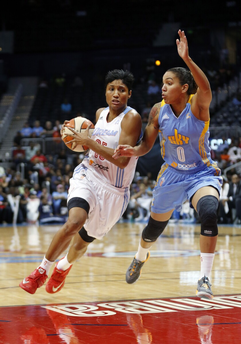 Atlanta Dream guard/forward Angel McCoughtry (35) drives against Chicago Sky guard Courtney Clements (0)