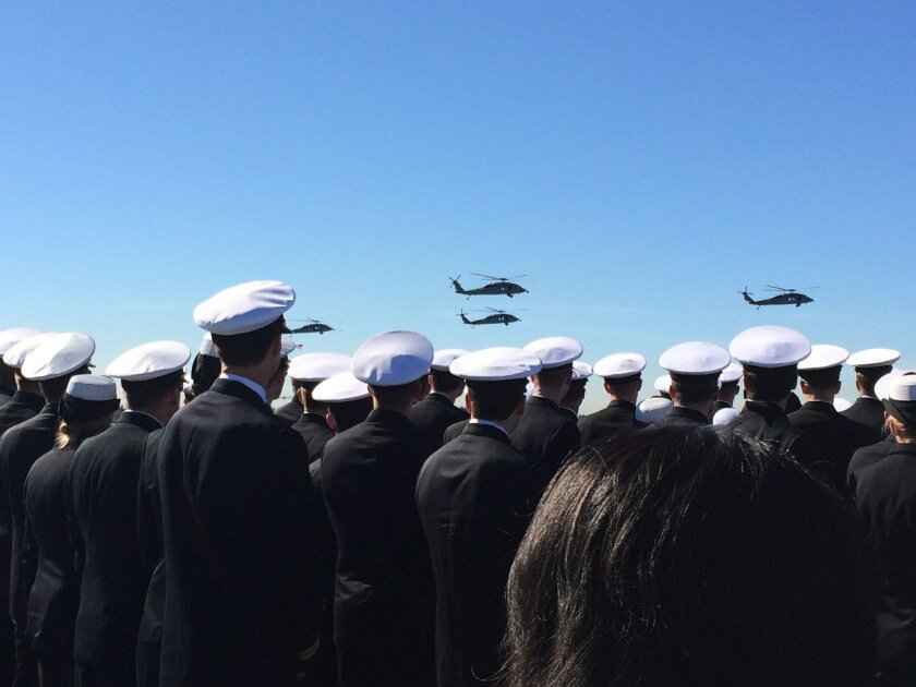 Navy helicopters fly past the USS Midway Museum during the memorial service for downed pilots Lt Cmdr. Landon Jones and Chief Warrant Officer Jonathan Gibson.