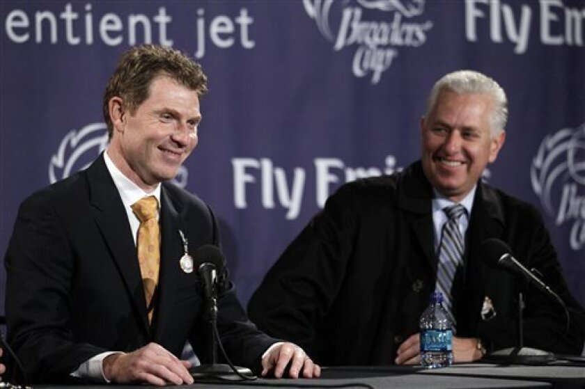 Owner Bobby Flay, left and trainer Todd Pletcher laugh as they talk about their horse More Than Real winning the Marathon race at the Breeder's Cup horse races at Churchill Downs Friday, Nov. 5, 2010, in Louisville, Ky. (AP Photo/Morry Gash)