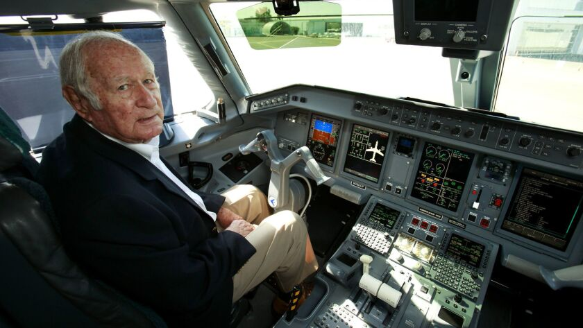 Ted Vallas, founder of Carlsbad based California Pacific Airlines, in the captain's seat on the flight deck of their Embraer 170 aircraft at McClellan-Palomar Airport.