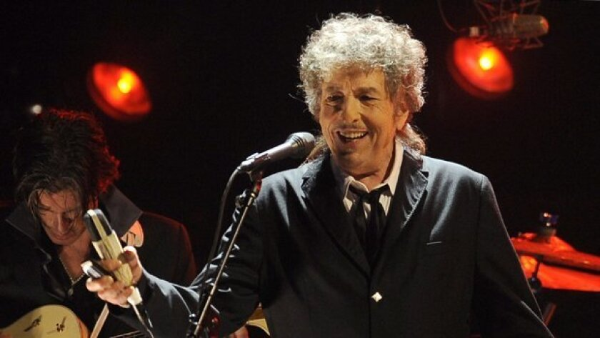Bob Dylan is set for his first San Diego concert since 2016. He is shown above with one of his band members, lead guitarist Charlie Sexton.