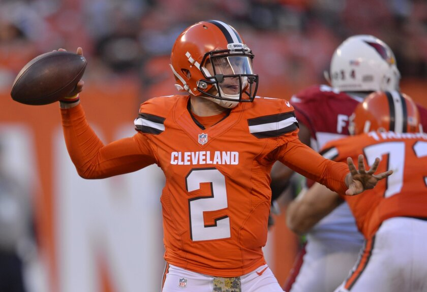 Cleveland Browns quarterback Johnny Manziel passes in the second half of an NFL football game against the Arizona Cardinals, Sunday, Nov. 1, 2015, in Cleveland. (AP Photo/David Richard)
