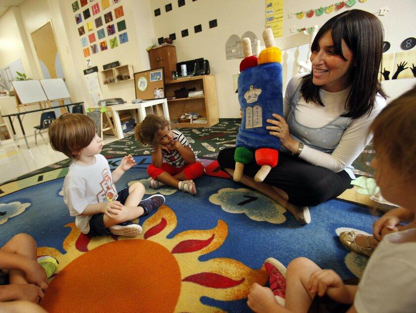 Soille Hebrew School  preschool director Rachel Eden used a plush Torah to discuss Yom Kippur with preschoolers.