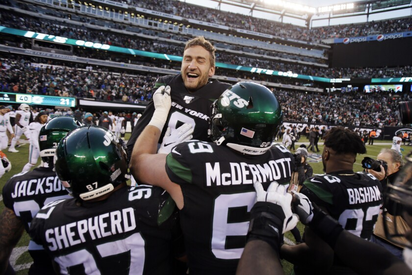 New York Jets kicker Sam Ficken (9) reacts with teammates after kicking the winning field goal during an NFL football game against the Miami Dolphins, Sunday, Dec. 8, 2019, in East Rutherford, N.J. (AP Photo/Adam Hunger)