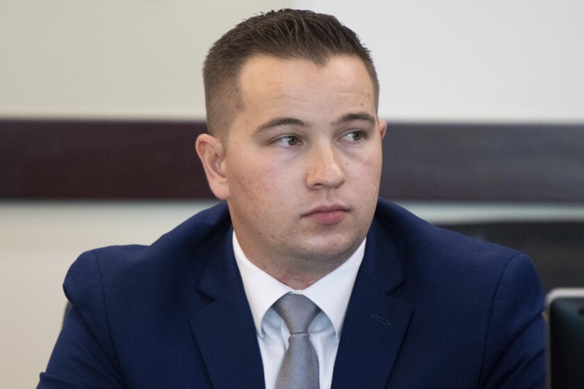 FILE - In this Nov. 13, 2019, file photo, Nashville Police Officer Andrew Delke sits in court as attorney David Raybin debates a new trial location at the Justice A. A. Birch Building in Nashville, Tenn. Prosecutors in Tennessee who are preparing for the first-degree murder trial of Delke, a Nashville police officer, next month may try to call a law enforcement expert witness who served similarly in the case against Derek Chauvin in George Floyd's death. (Courtney Pedroza/The Tennessean via AP, File)
