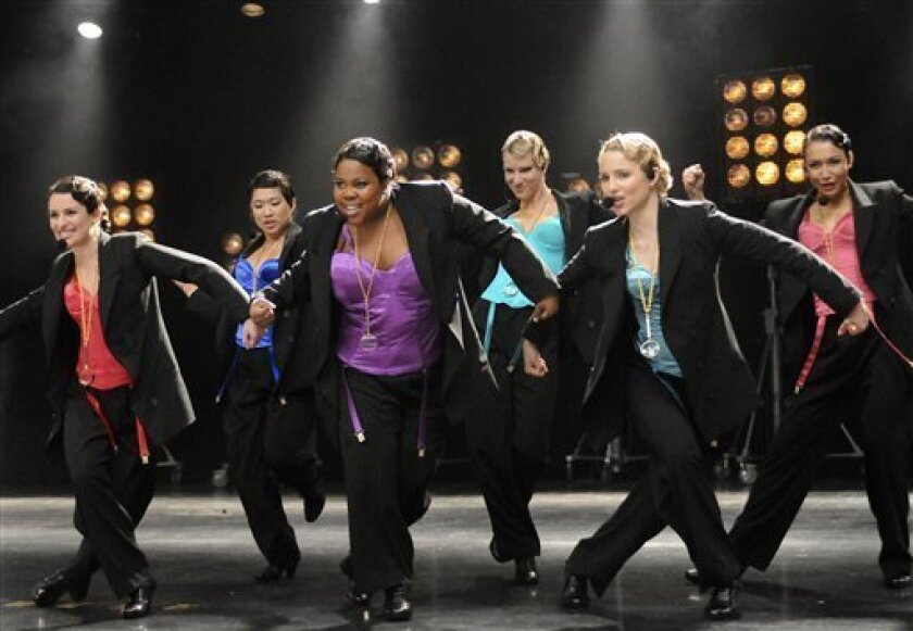 """FILE- In this file publicity image released by Fox, from left, Lea Michele, Jenna Ushkowitz, Amber Riley, Heather Morris, Dianna Agron and Naya Rivera perform in """"The Power of Madonna"""" episode of """"Glee"""". (AP Photo/Fox, Michael Yarish, FILE) NO SALES"""
