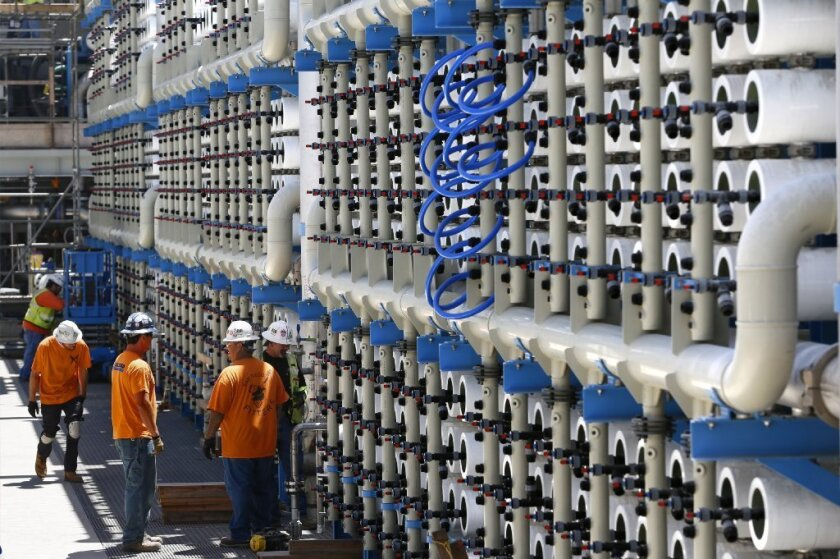 Row upon row of cylinders containing permeable reverse-osmosis filters are seen at Poseidon Water's desalination plant in Carlsbad.