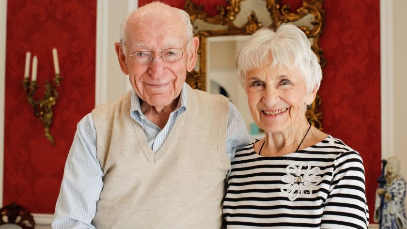 Blaine Briggs and his wife of 70 years, LaVerne, pose for photos at their home in Carlsbad, California.