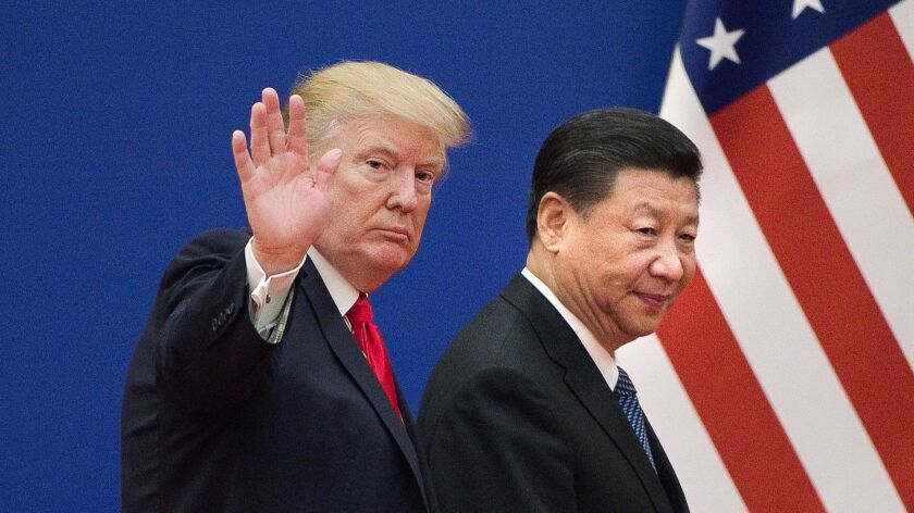 President Trump and China's President Xi Jinping leave a meeting together in Beijing in 2017. Their trade war continues.