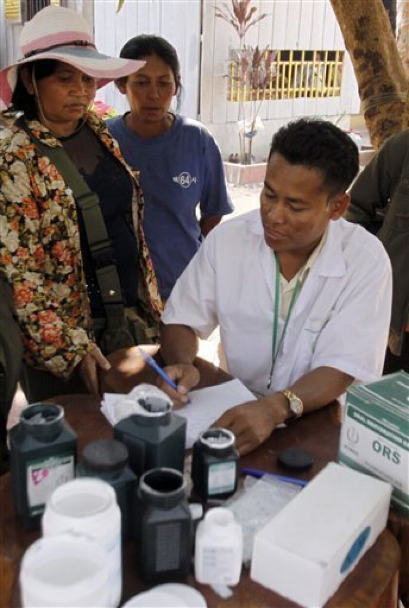 A Cambodian health officer, right, supplies medicine to refugees at Wat Kiri Tuol Andet at a village, east of the famed Preah Vihear temple in the Cambodia-Thailand border province of Preah Vihear in Cambodia Monday, Feb. 7, 2011. Cambodia called for U.N. peacekeepers to help end the fighting along