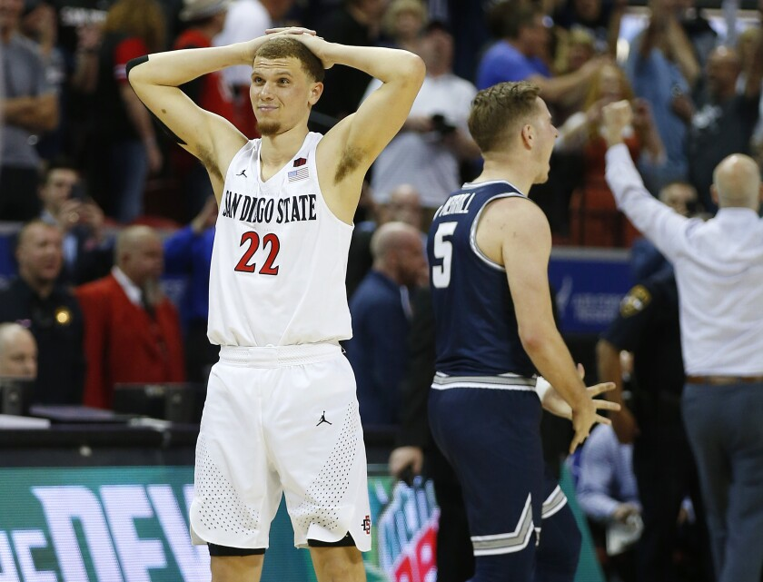 San Diego State's Malachi Flynn reacts after his last-second 3-point attempt bounced off the rim, giving Utah State a victory in the Mountain West Tournament final Saturday in Las Vegas.