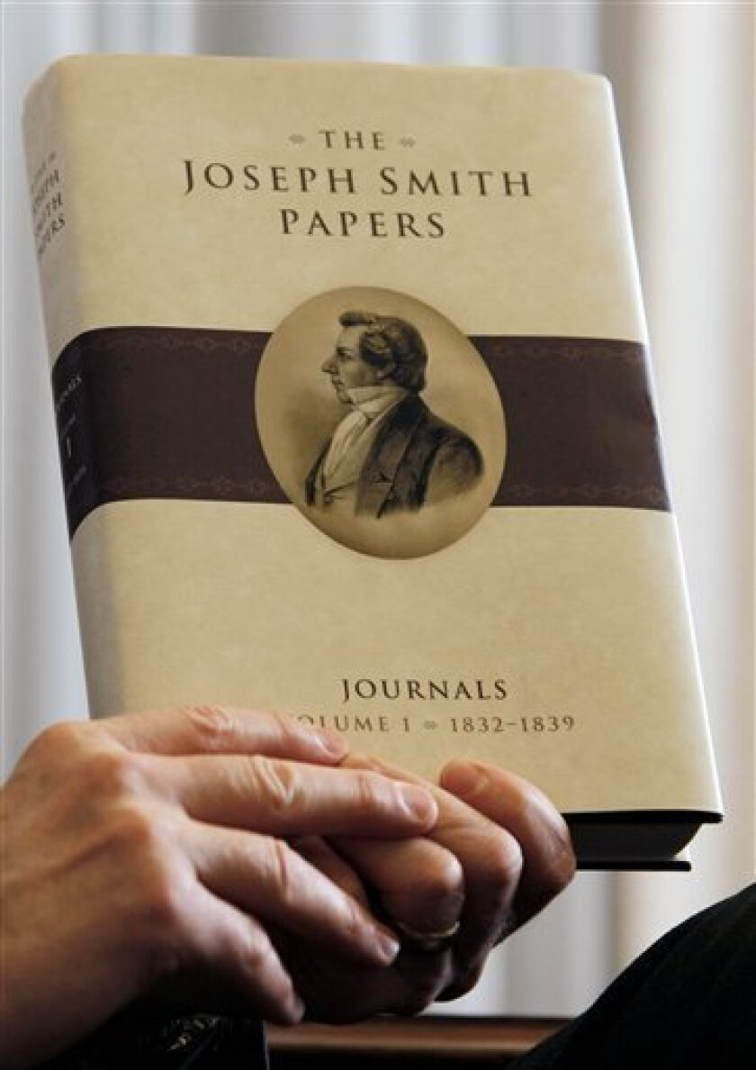 """Richard Turley Jr. a Mormon church historian, holds a copy of the newly released """"Joseph Smith Papers"""" book in Salt Lake City Monday, Dec. 1, 2008. The 500-page book chronicles the church founder's journals between 1832 and 1839. It's the first in a series expected to run 30 volumes and the inaugural work of The Church Historian's Press. (AP Photo/Scott G. Winterton/Deseret News)"""