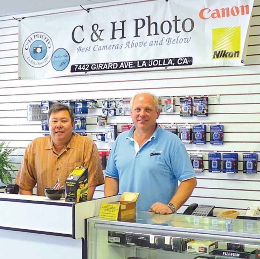 C&H Photo co-owners Leon Chow and Dave Hinkel inside their store at 7442 Girard Avenue. A Kiwanian and LJVMA board member, Chow has been selected as a recipient of Prince Chapel's 'Pillar of Light' award.