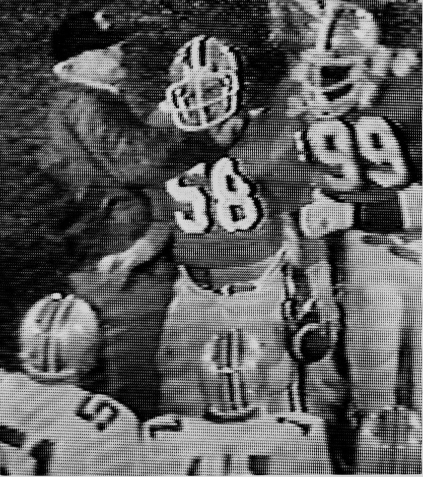 FILE - This Dec. 30, 1978 file photo,  shot from a monitor at the ABC studios in Washington, shows Ohio State University coach Woody Hayes, left, during an incident involving Clemson University football player Charlie Bauman (58) on the sideline at the Gator Bowl in Jacksonville, Fla. Hayes was fir